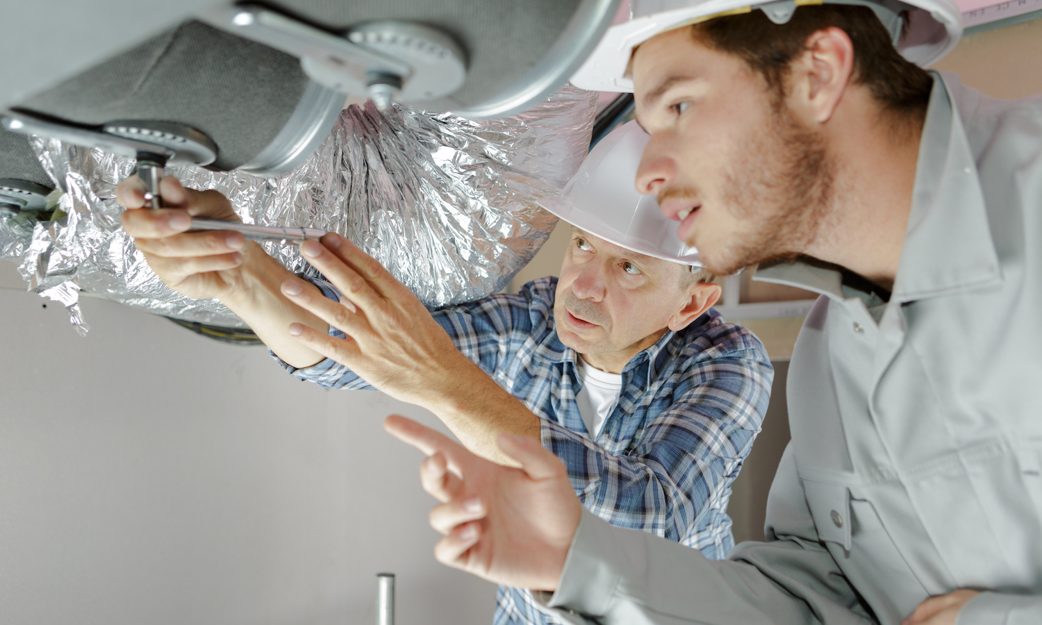 HVAC workers fixing ventilation