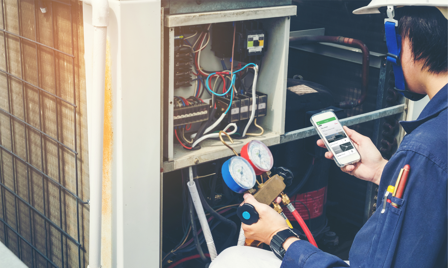 Contractor Using the Best HVAC Software on Smartphone